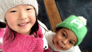 Naleigh and Adalaide Wearing Knitted Apparel