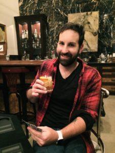 Josh Kelley Enjoying A Cocktail