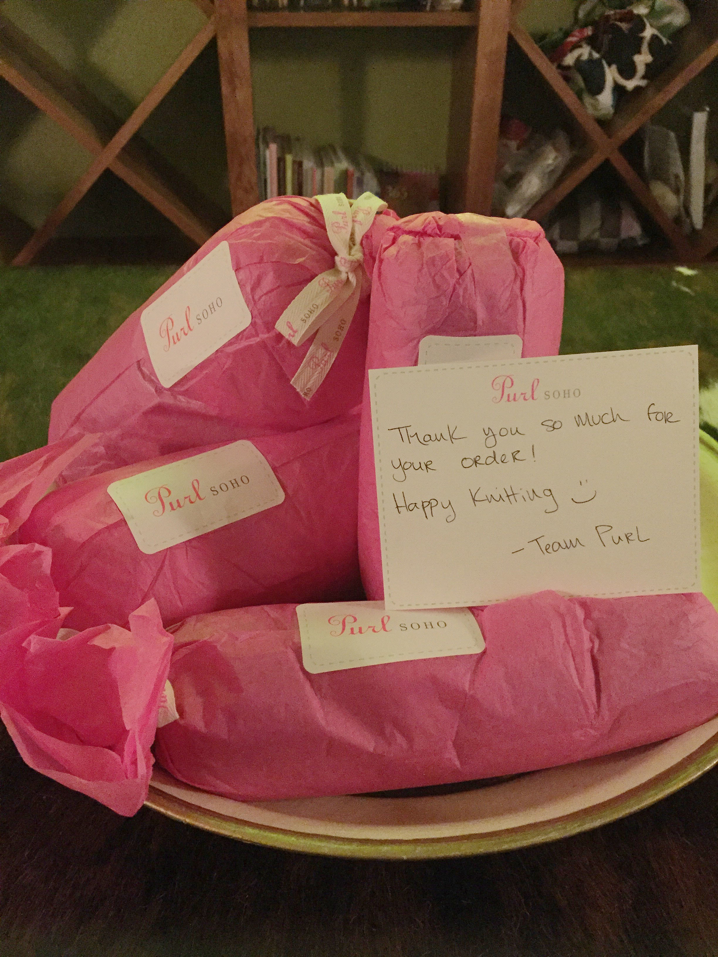A hot pink surprise underneath that brown paper!