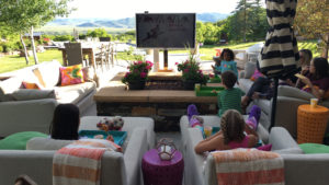 A classic kid movie, delicious food, and a candy cart for dessert. What a life these kids have!