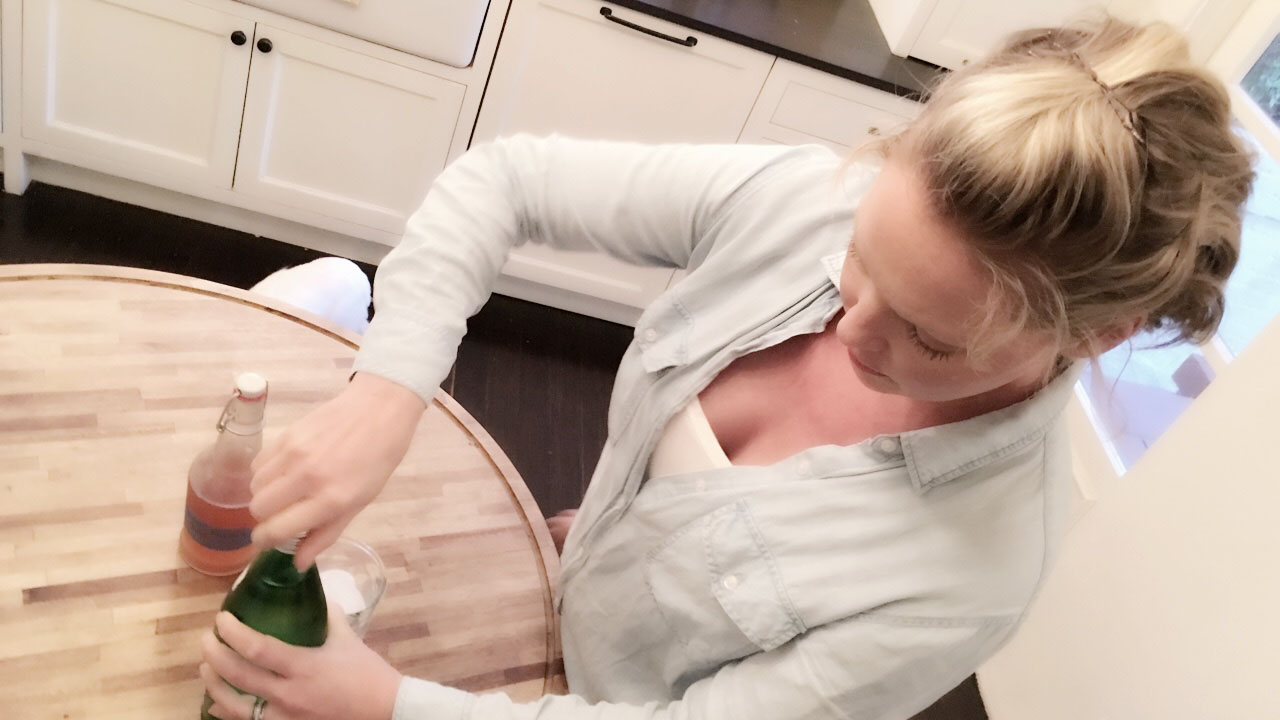 Mixing up some of my magic pregnancy elixir while wearing my favorite Rails button down.