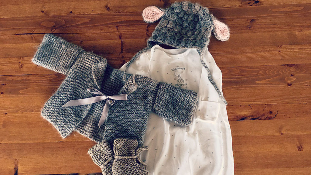 My mother knit the hat, booties and sweater and also gifted us the sweet baby sleep sack.
