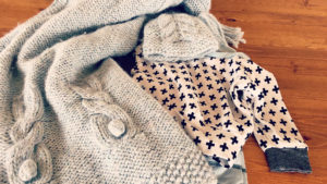 Cute little cable knit bunnies make this blanket incredibly sweet and special!