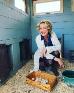 Katherine Heigl collecting eggs from her chicken coop