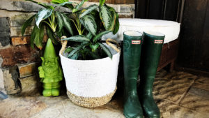 The opposite corner was looking a bit bare so I grabbed the wicker ottoman that goes with the arm chair and threw a potted plant, a silly green garden gnome I've had since last year and my green hunter boots in front of it to create a spot for pulling those boots on and off.