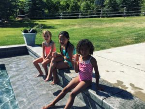 Adalaide and friends by the pool