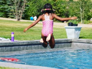 Adalaide jumping into the pool