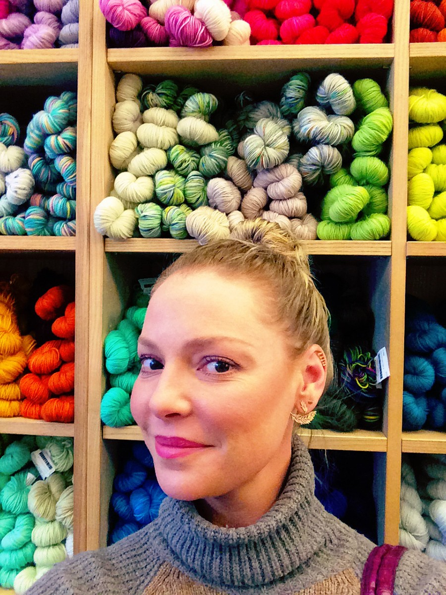 Katherine Heigl Standing In Front Of Colored Yarns
