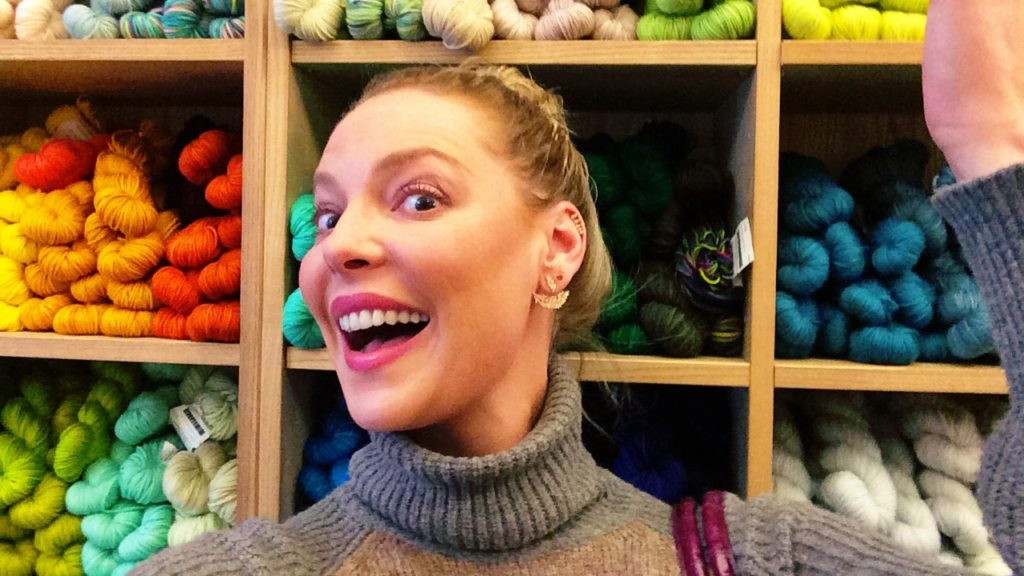 Katherine Heigl showing off various colored yarns at Purl Soho in New York