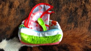 One small pouch with a bib, spoon and room for my baby food jars.