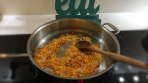Carrots, onions and garlic sautéing