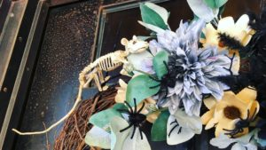 Spooky wreath with creepy crawlies and skeletons