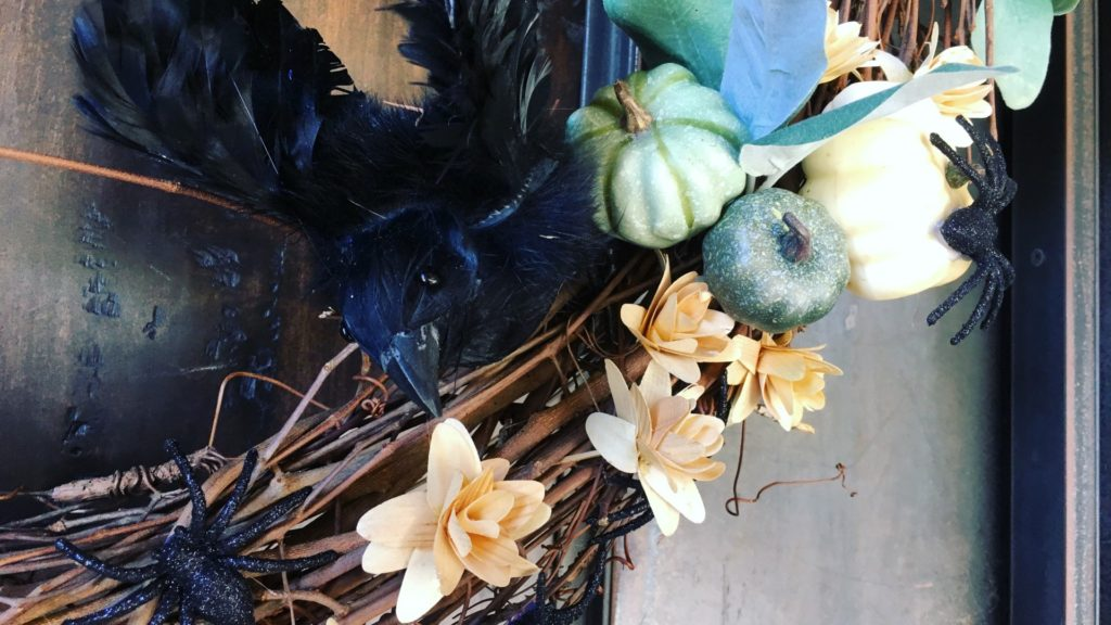 Spooky wreath with creepy crawlies and ravens