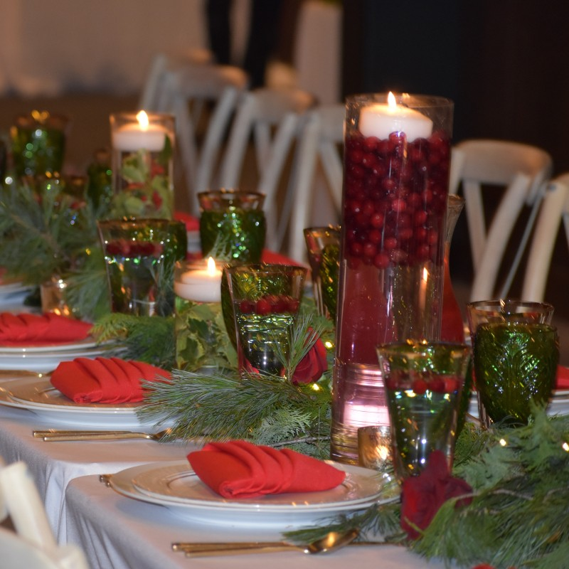 The center of the table was thoughtfully decorated with fresh greens and floating votives.