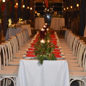 All the guests were seated together at one long farm table.