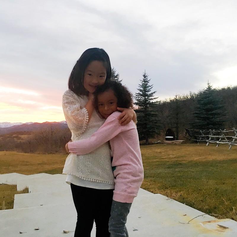 Naleigh and Adalaide share a hug