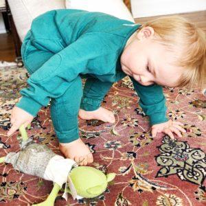 Joshua Jr. in Little Borne outfit holding a Hazel Village creature