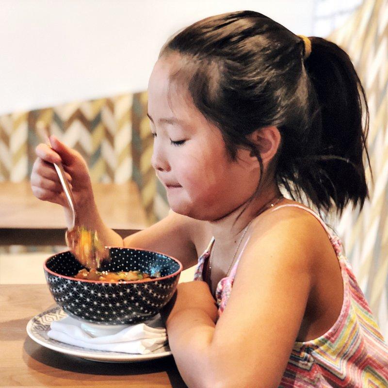 Naleigh eating at Planta Restaurant