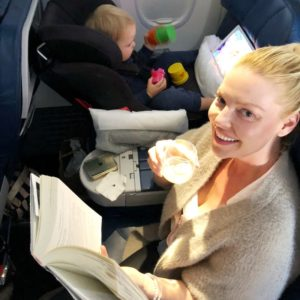 Katherine Heigl enjoying her flight with a cocktail and a good book