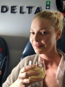 Katherine Heigl enjoying a cocktail on her flight
