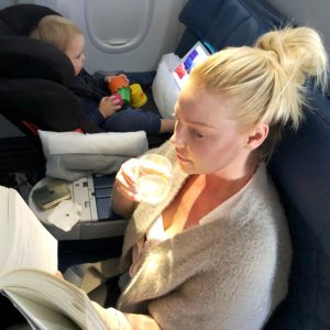 Katherine Heigl reading and enjoying a cocktail while Joshua Jr. plays with his toys